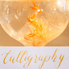 bright gold calligraphy and ink in water