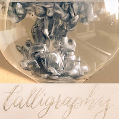 silver calligraphy and ink in water