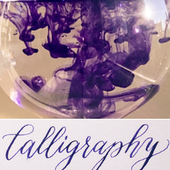 violet calligraphy and ink in water