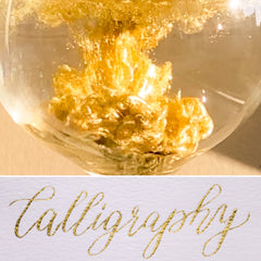antique gold calligraphy and ink in water