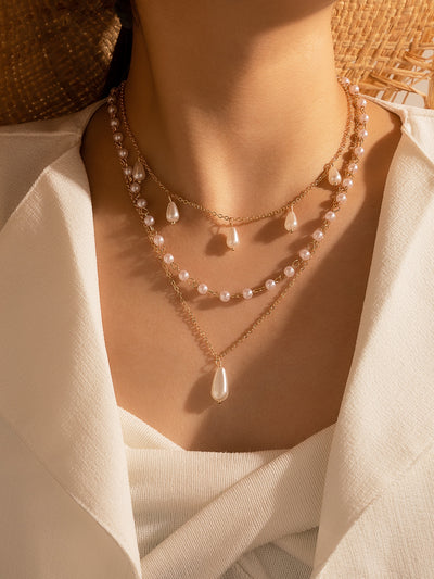 faux pearl pendant layered chain necklace, female model view 1