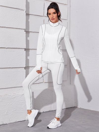 white slim fit funnel neck long sleeve tracksuit top and long high stretch leggings set, female model view 1