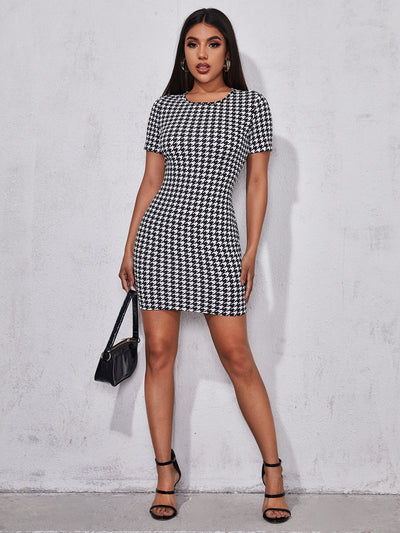 round neck short sleeve black and white houndstooth pattern mini dress, female model view 1