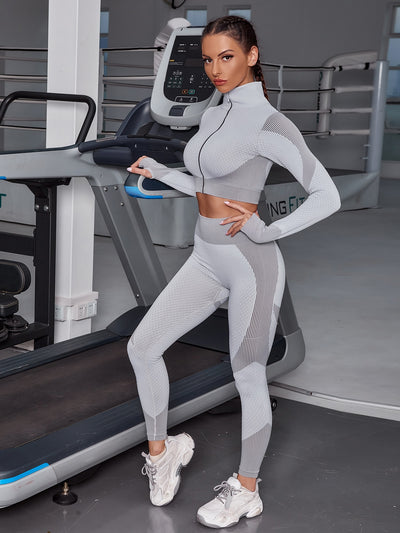 grey funnel neck zipper front seamless gym crop top and skinny gym leggings set, female model view 1