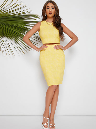 sleeveless yellow round neck camisole crop top and knee length pencil skirt set, female model view 1