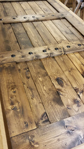 36x84 Wood Barn Door - Barn door is finished in Provincial stain and wax sealed.  Embellished with iron clavos (nail heads) add character.  Front pull on door NOT included.