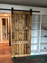 Load image into Gallery viewer, 36x84 Wood Barn Door - Barn door is finished in Provincial stain and wax sealed.  Embellished with iron clavos (nail heads) add character.  Front pull on door NOT included.