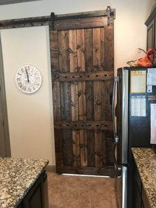 36x84 Wood Barn Door - Barn door is finished in dark walnut and wax sealed.  Embellished with iron clavos (nail heads) add character.  Front pull on door NOT included.