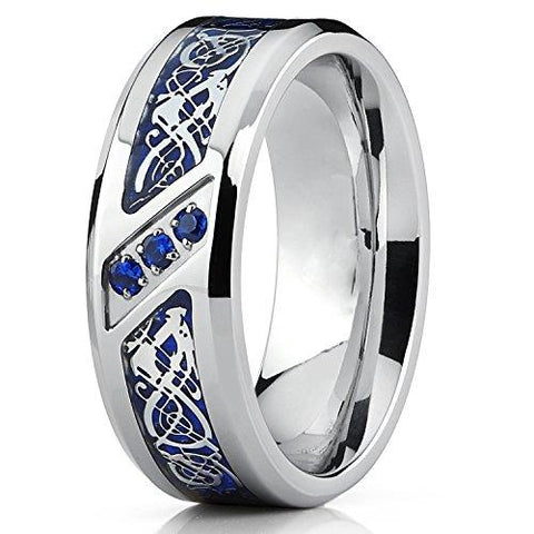 Titanium Ring with Dragon Pattern Over Blue Carbon Fiber Inlay and Azure Cubic Zirconia
