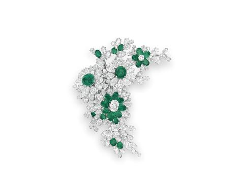 An Emerald and Diamond Flower Brooch by Bulgari