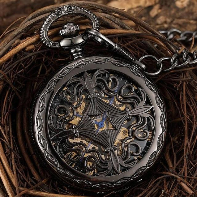 Black and Gold Pocket Watch with Hollow Carved Design