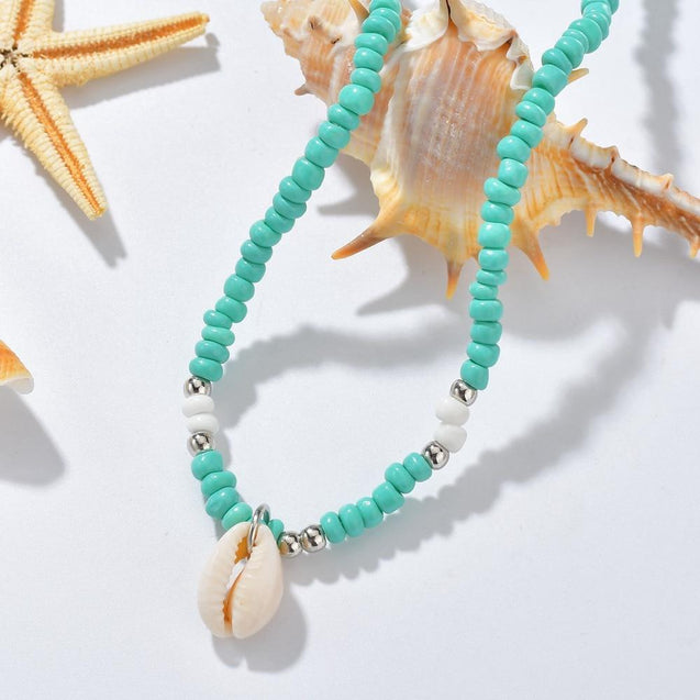 Blue and White Beaded Necklace with Puka Shell Pendant - InnovatoDesign