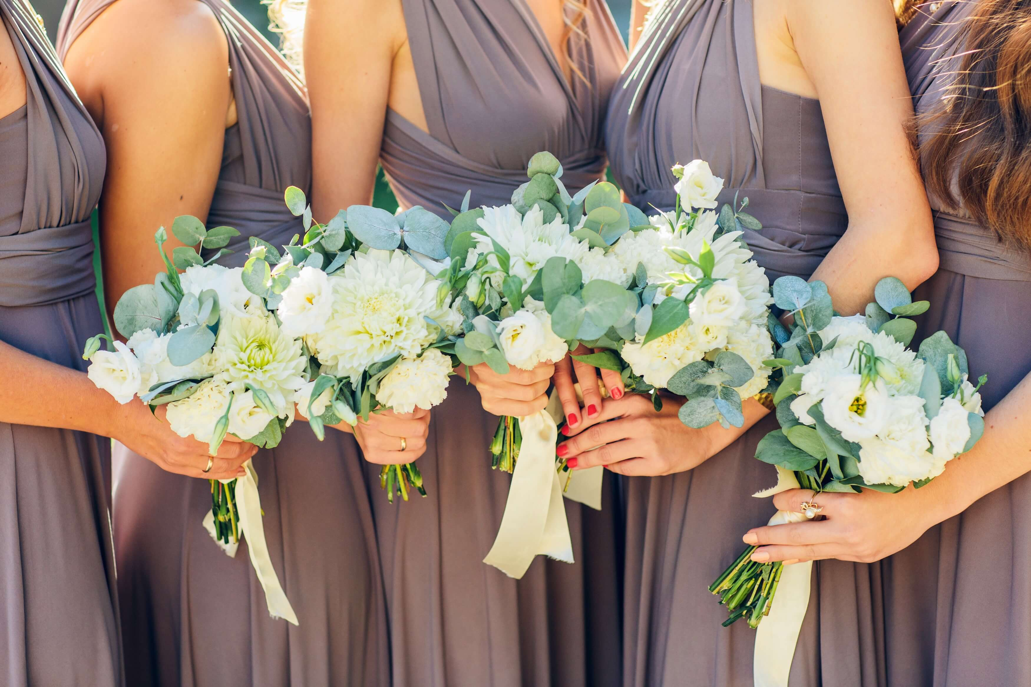Bridemaids with beautiful flowers and designer jewelry