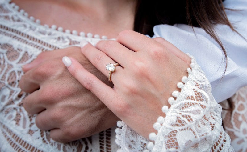 womans hand with diamond ring