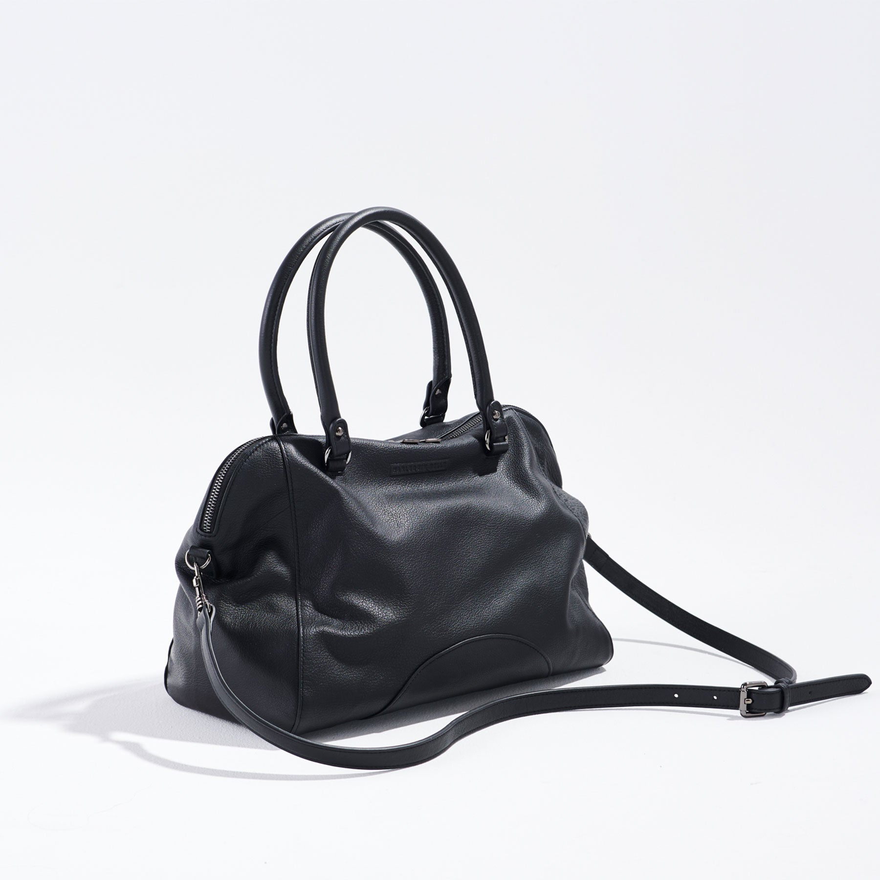front view of large black leather handbag