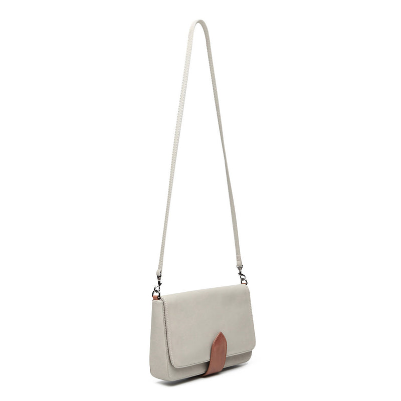 front view of grey leather crossbody handbag with tan trim clasp