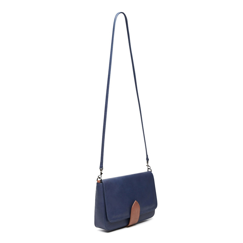 front view of midnight blue leather crossbody handbag with tan trim clasp