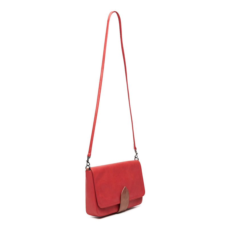 front view of pomegranate red leather crossbody handbag with tan trim clasp