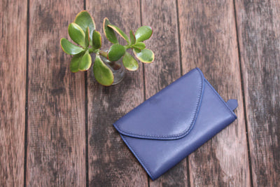 Harlequin Belle Wanderlust Wallet Midnight Blue Leather Table Flat Lay