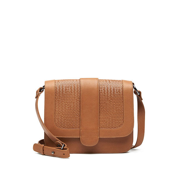 front of tan leather crossbody handbag