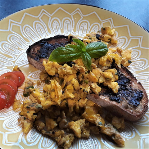 Scrambles eggs on toasted sourdough with black garlic butter