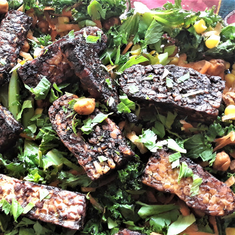Chilli tempeh on a bed of kale