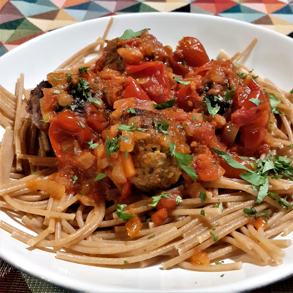 Herby pork balls in a spiced tomato sauce on a plate ready to eat
