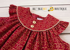Amazing Stars Sitter Dress yoke close-up showing gold piping and gold buttons
