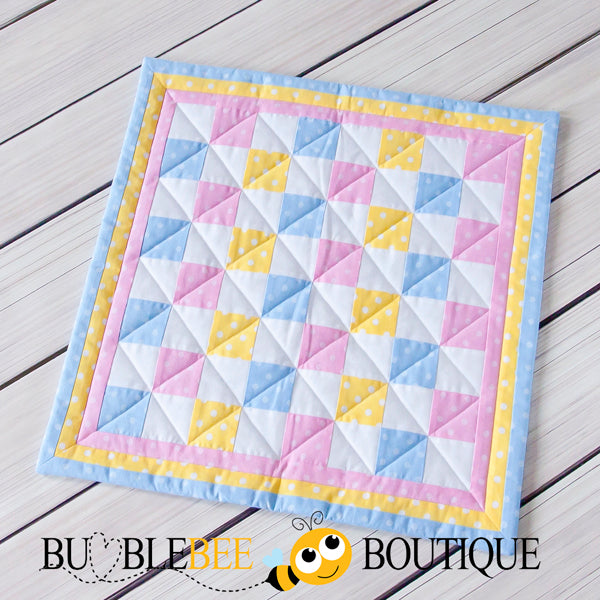 Baby Dots pink, blue & yellow mini patchwork quilt front
