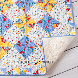 Blue & Yellow Pinwheel design Fruit Salad Patchwork Quilt corner turned up to show backing