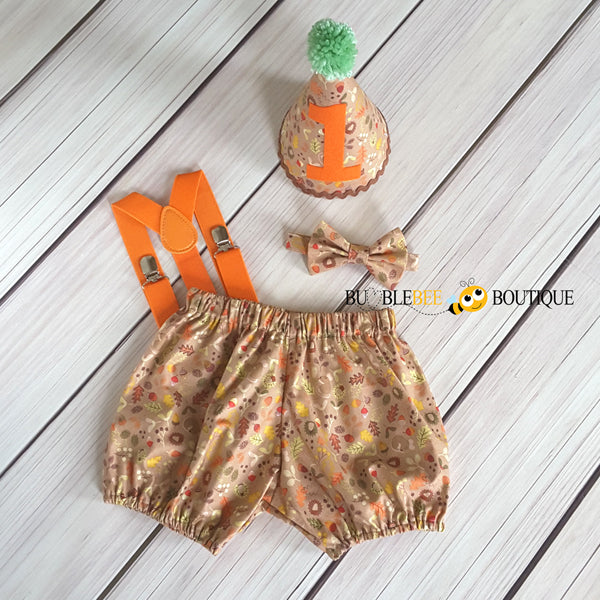 Woodland cake smash outfit with burnt orange suspenders