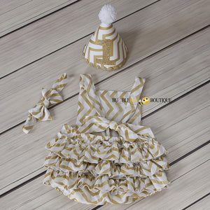 Back view of White & Gold Glimmer Chevron Girls' Cake Smash Outfit. Romper, headband & party hat.