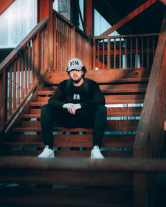 Urban staircase picture. BTM Hat and Sweatshirt. Essential Sweatshirt. Break The Mould. Golden hour photography.