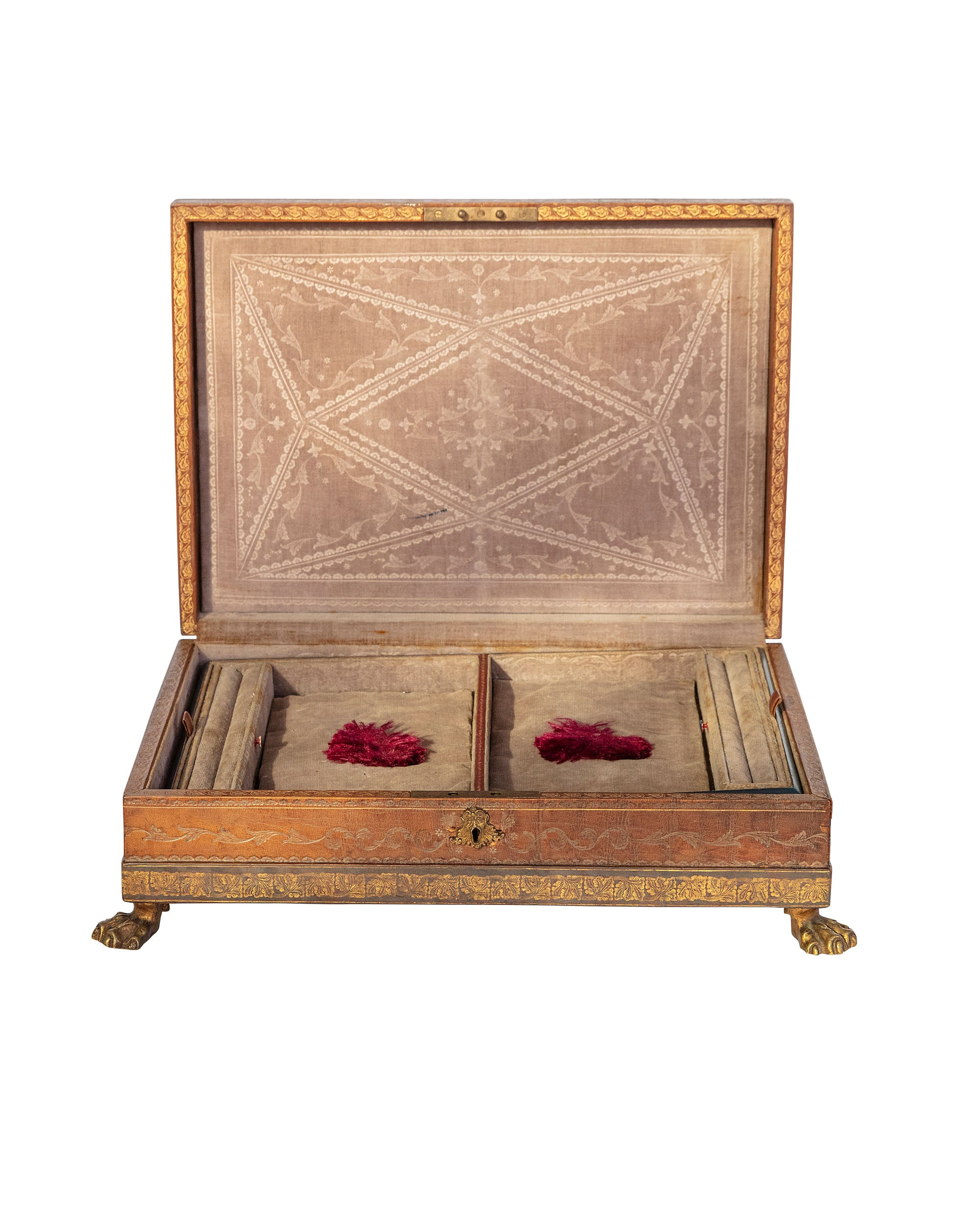 Engraved leather-lined jewelry box with brass feet and velvet interior