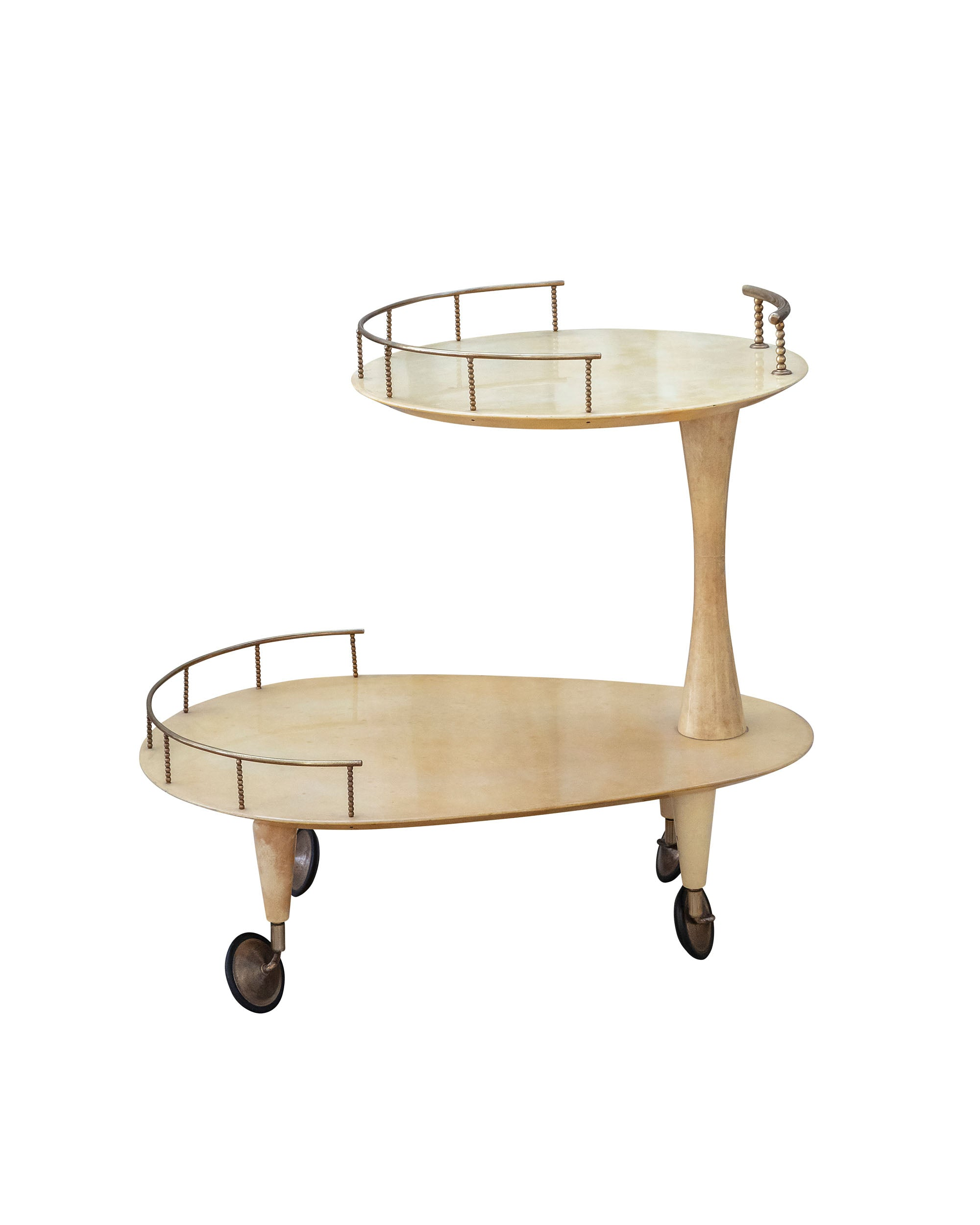 Brass and lacquered parchment trolley. Aldo Tura. Italy