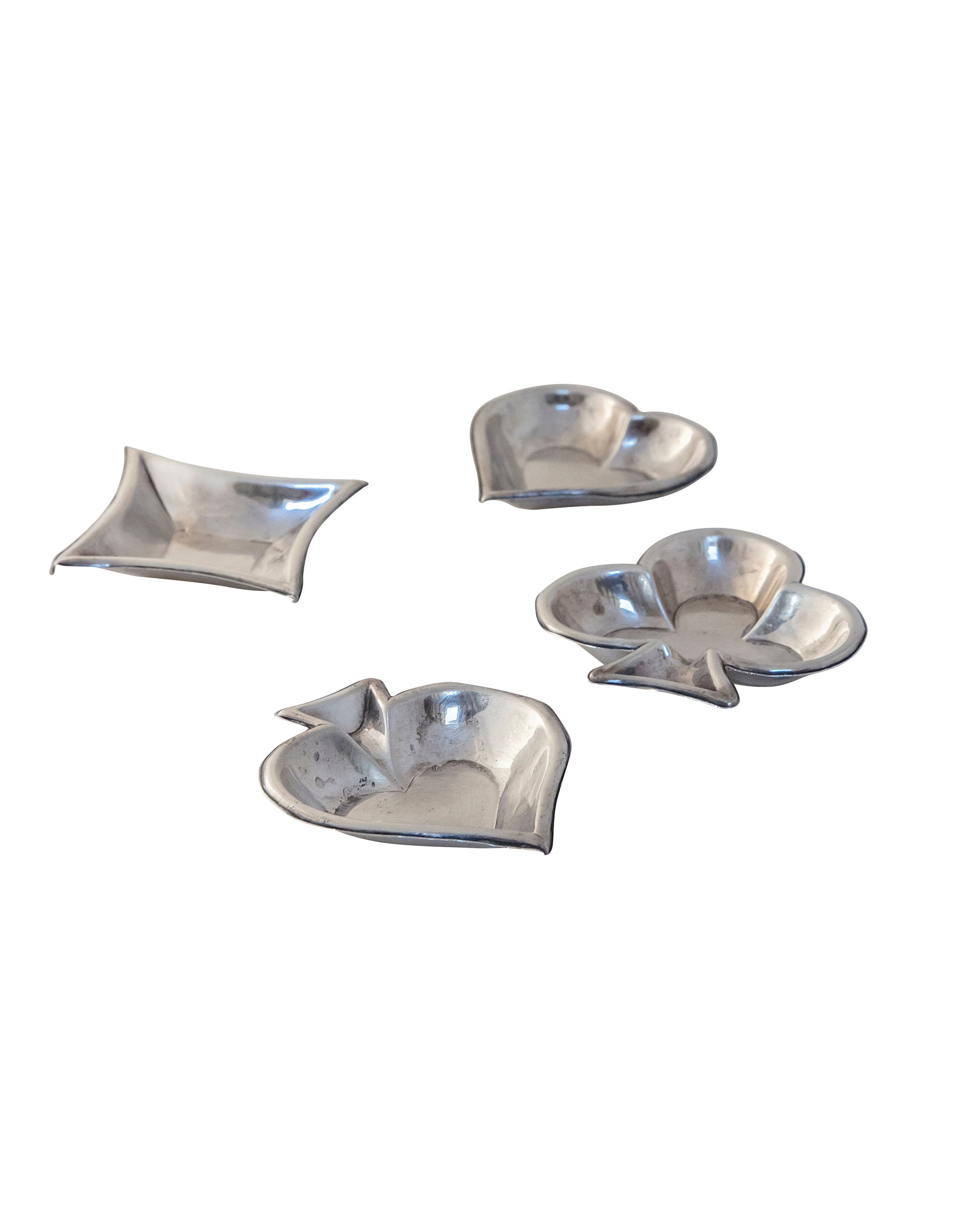 Set of four metal ashtrays shaped like the different suits of the deck