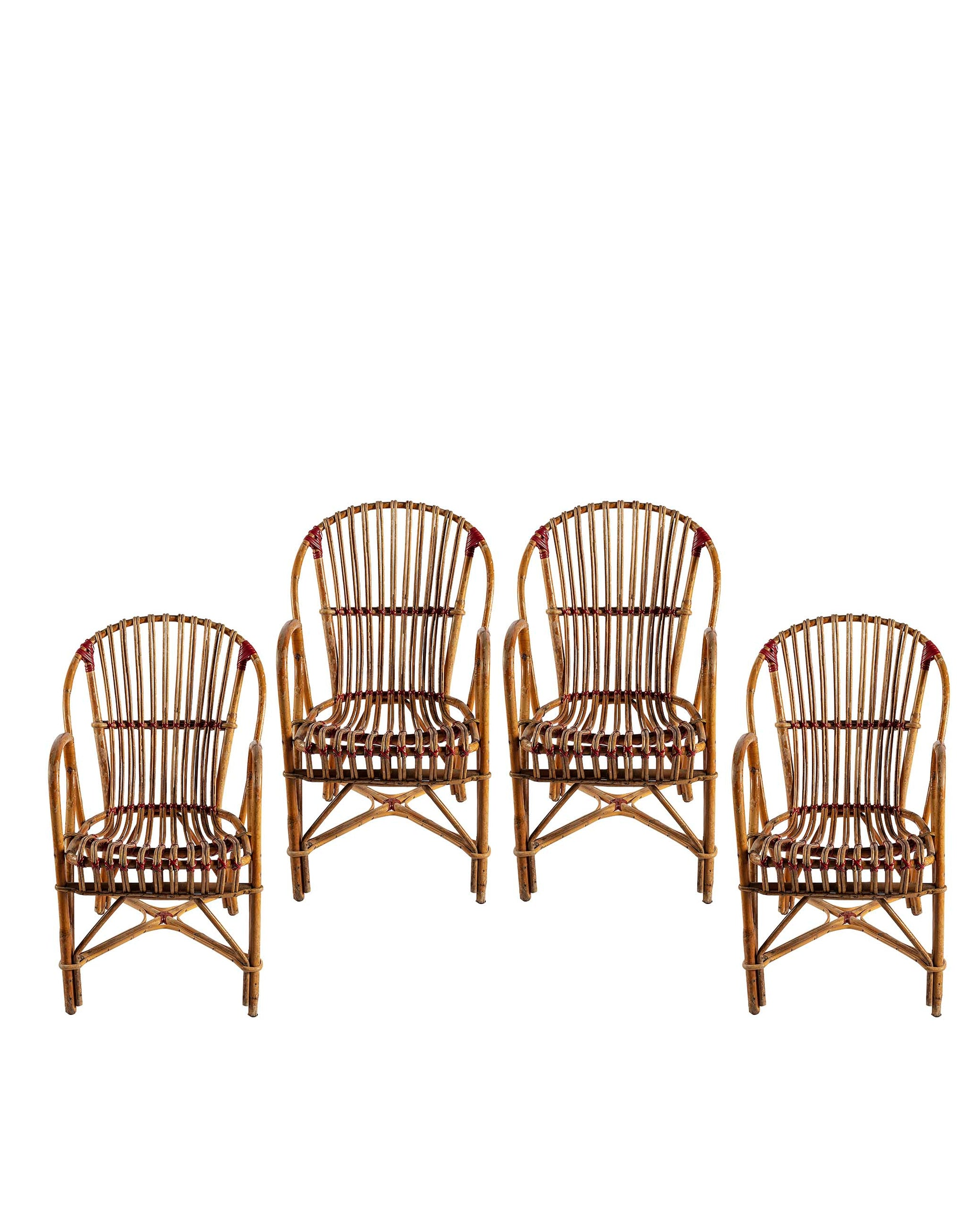 Set of four rattan armchairs. France, 1940s