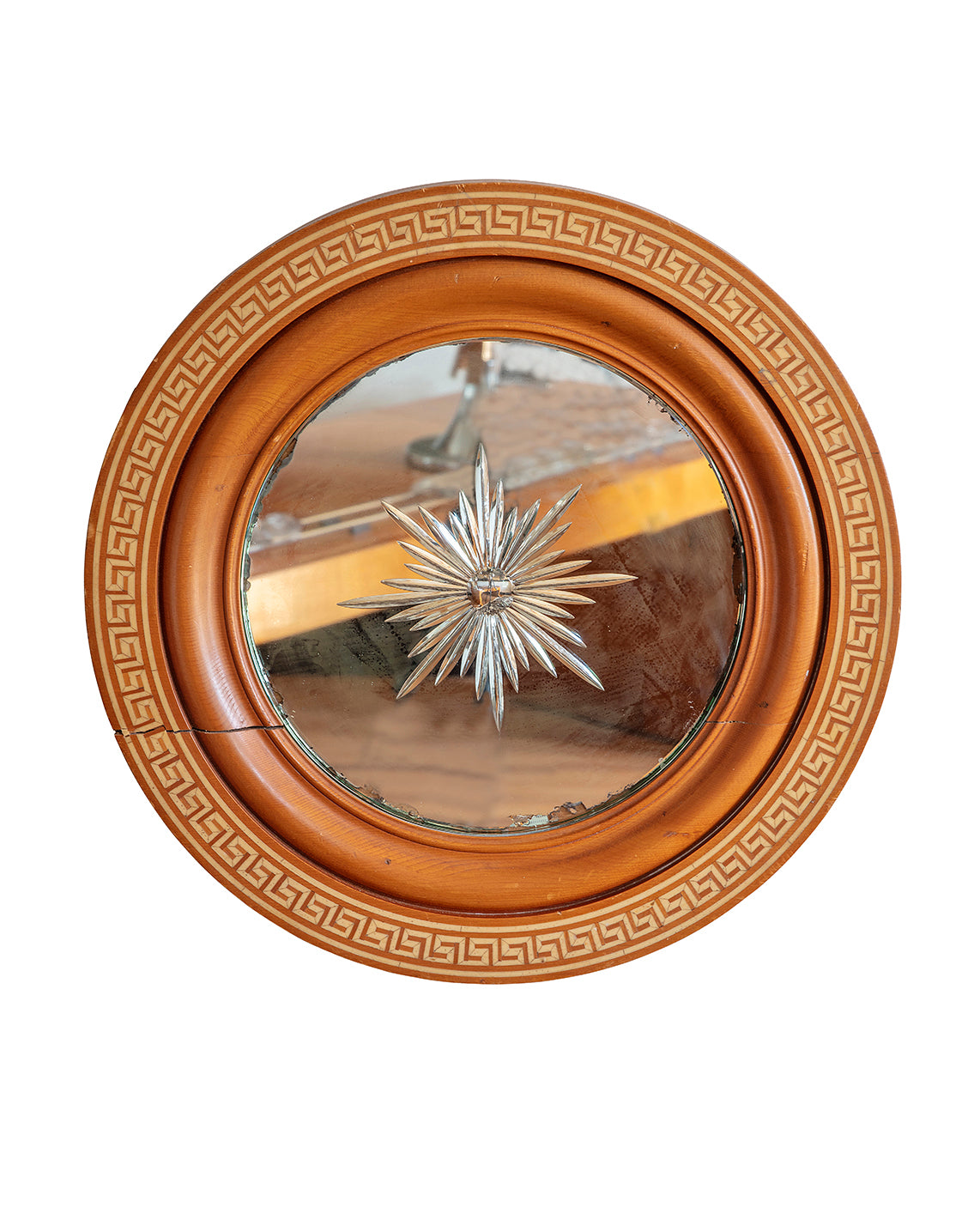 Round mirror with a carved moon