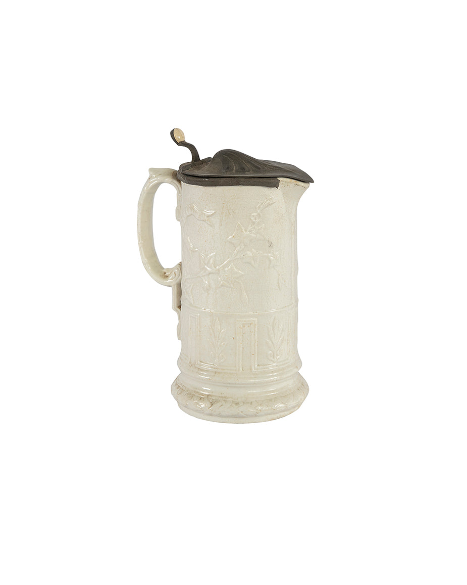Carved porcelain jug with a pewter lid