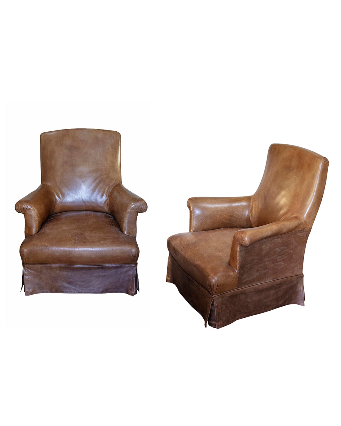 Pair of brandy leather armchairs