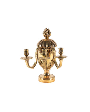Pair of candelabra with three candle holders in golden bronze