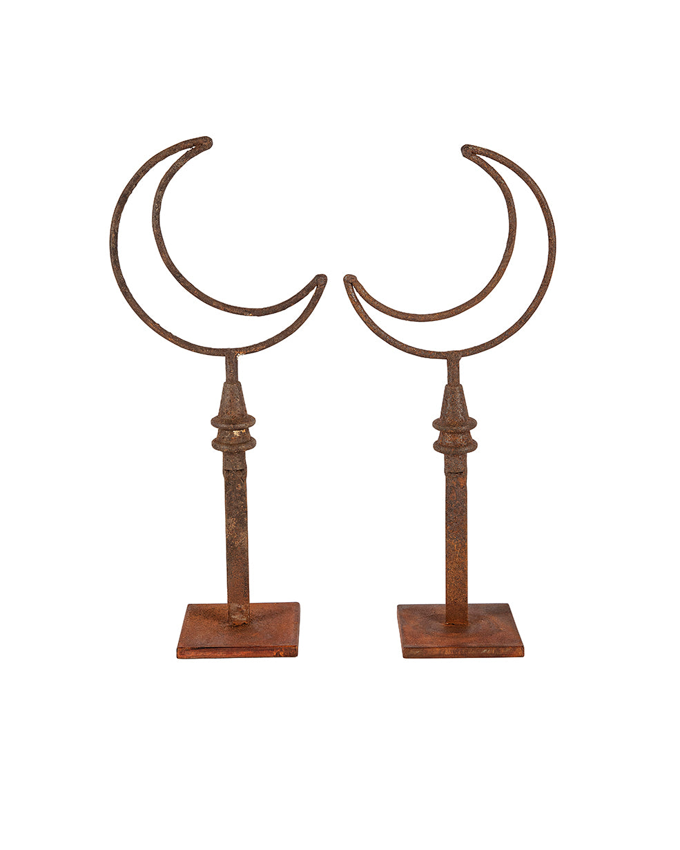 Pair of moon-shaped iron sculptures