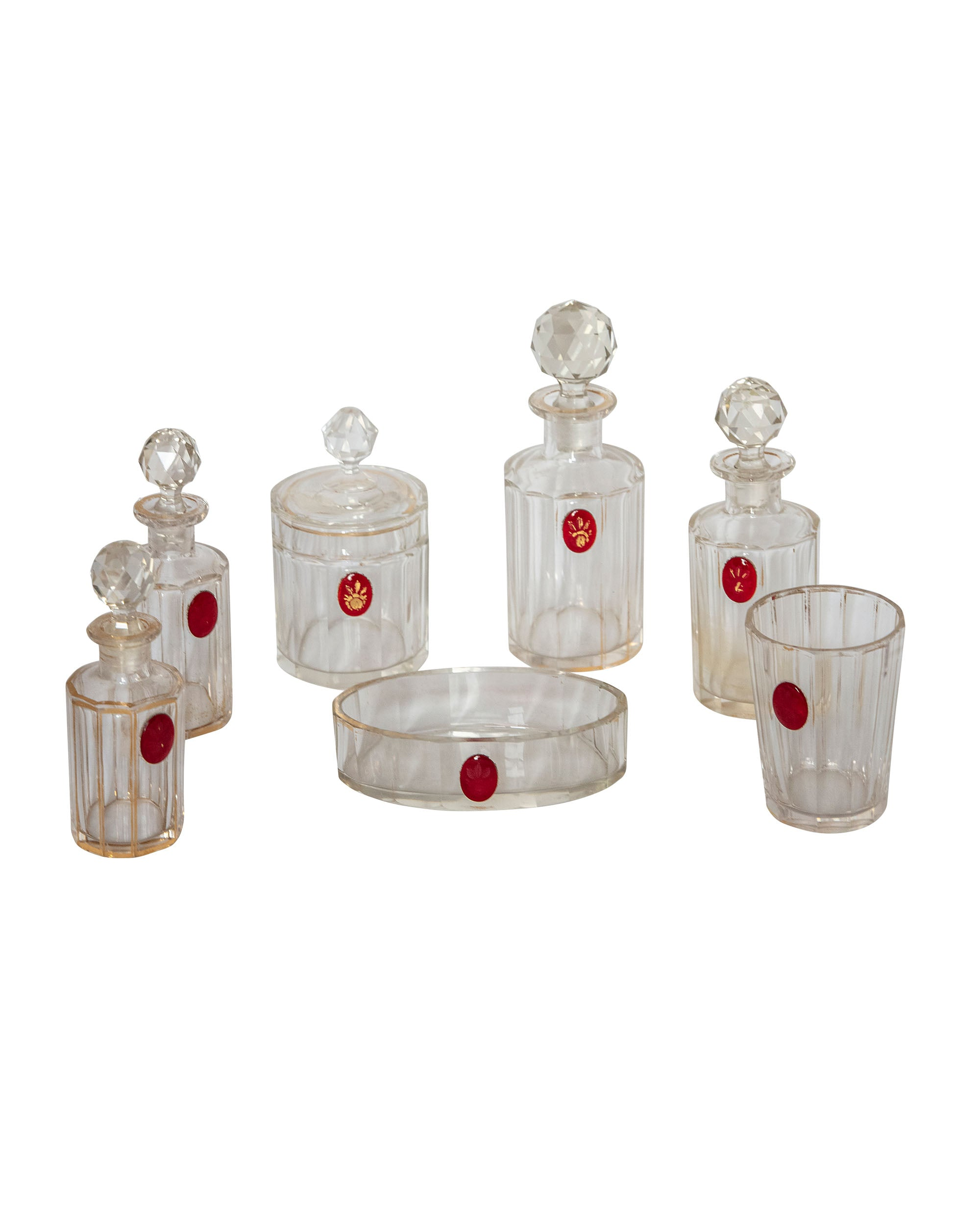 Bathroom set consisting of seven pieces made of glass with golden edge and seal on red glass
