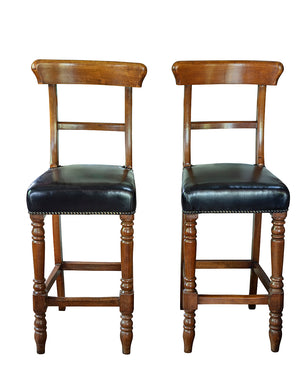 Pair of wood and leather bar stools. Beginning of the XXth century