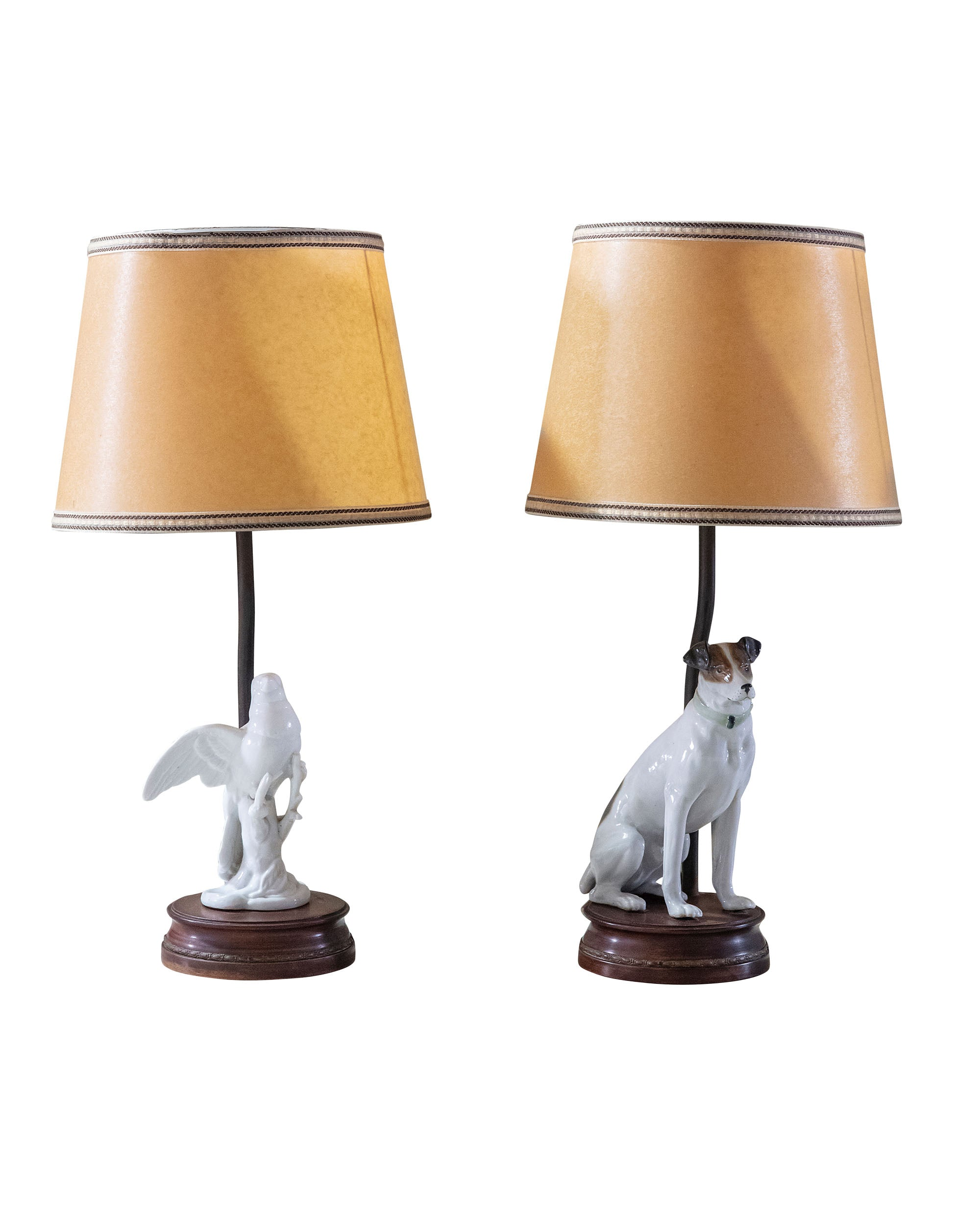 "Pair of porcelain lamps ""dog and bird"" on wooden base"