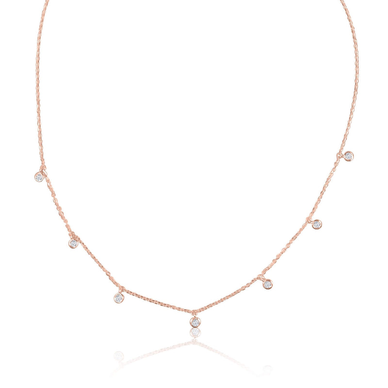 A classic must-have to complement any look, this rainfall 18k gold necklace features seven dangling set diamonds
