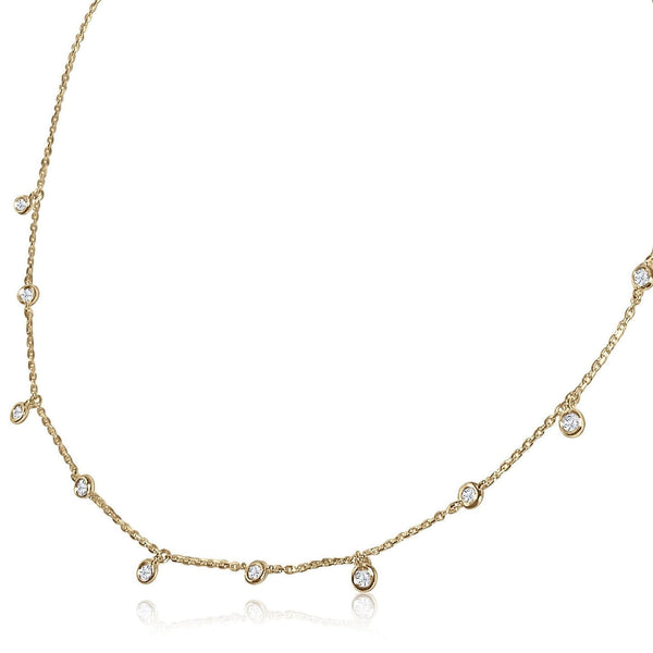 A classic must-have to complement any look, this rainfall 18k gold necklace features 11 set diamonds