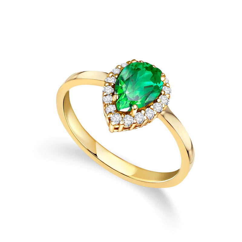 Pear shaped halo colored rings. Choose between: Emerald Green, Blue Sapphire, Red Ruby and Pink Tourmaline.   Available in yellow, white and rose 18k gold.