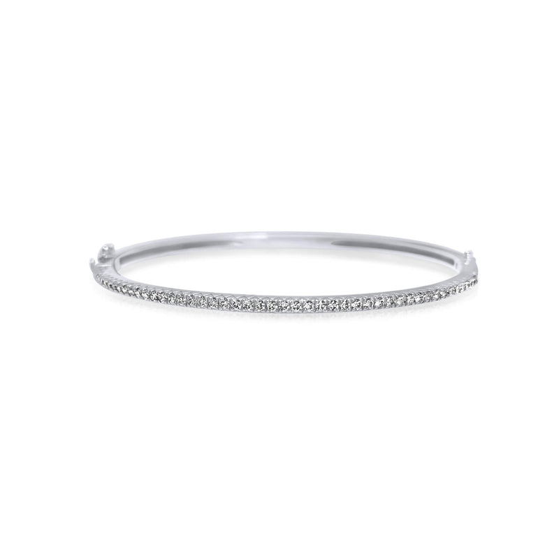 A classic thin Diamond bangle bracelet, elegant, effortless on its own and magnificent layered. The bangle has a safety clasp to keep it in place.  Available in 18K yellow, white and rose Gold.