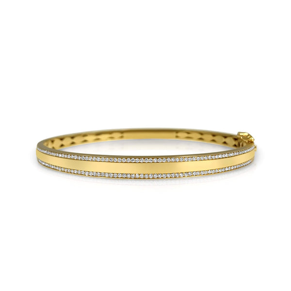 14K solid Gold (9.7g), Pavé Diamonds (0.5 carats). A gorgeous bangle bracelet that would go perfectly alone or stacked for the perfect arm candy! The bangle has a safety clasp to keep it in place. Available in Yellow, White and Rose Gold.